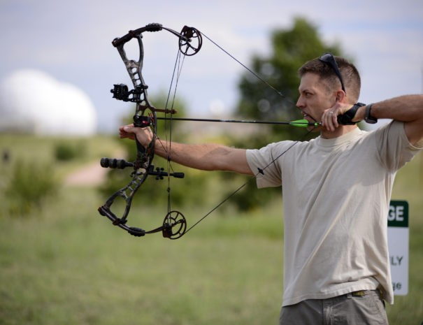 SCHRIEVER AIR FORCE BASE, Colo. – Tim Paget takes aim during an archery competition held on base Aug. 23.  Paget beat out 11 other competitors to take first place after two rounds of sharp shooting. (U.S. Air Force photo/Christopher DeWitt)